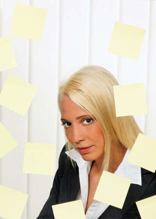 Stressed-out young woman with multiple assignments memos Stock Photo - 8114902