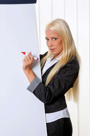 Young business woman on a flip chart created graph photo