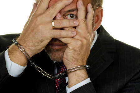 Manager arrested with handcuffs Stock Photo - 8114882