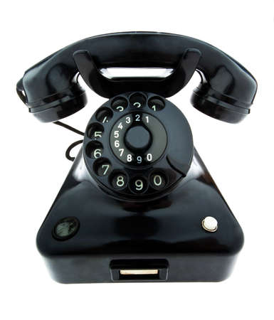 custumer: An old, old landline telephone. Phone on a white background. Stock Photo