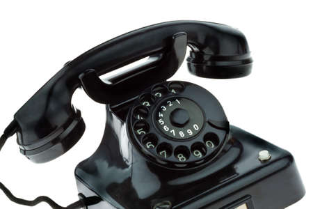 An old, old landline telephone. Phone on a white background. Stock Photo - 8114850