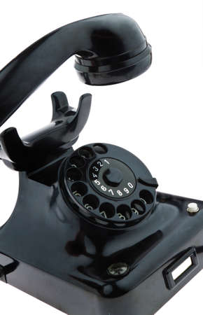 An old, old landline telephone. Phone on a white background. Stock Photo - 8114830