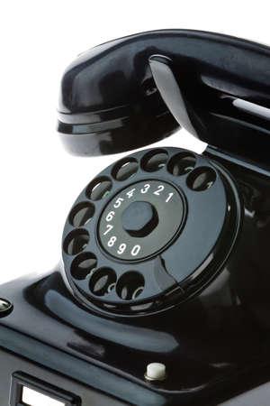 custumer: An old, old landline telephone. Phone on a white background. Stock Photo