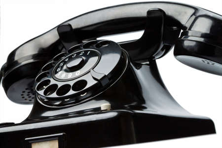 An old, old landline telephone. Phone on a white background. Stock Photo - 8114943