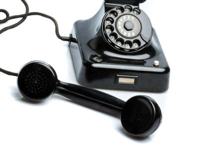 An old, old landline telephone. Phone on a white background. Stock Photo - 8114835