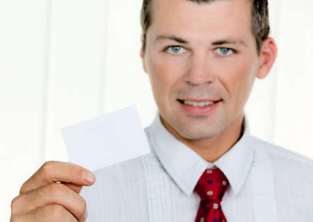 Successful entrepreneurs shows a blank business card Stock Photo - 8118512