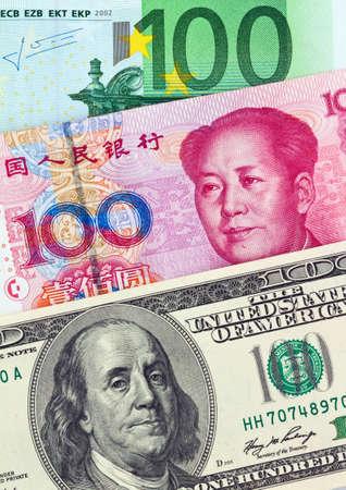 parity: American dollars, European euro and chinese yuan bills