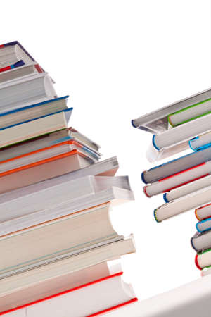 reading material: Stack of books. Isolated and insulated orphaned background Stock Photo