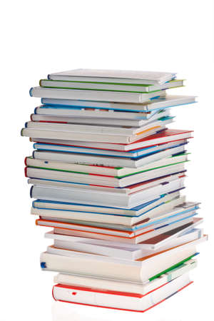 stacked books: Stack of books. Isolated and insulated orphaned background Stock Photo