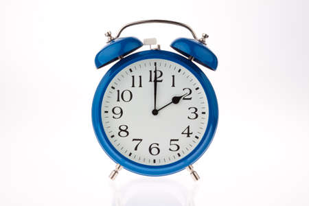 Alarm clock as a symbol of time change from summer to winter time photo