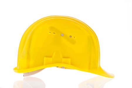 A construction worker hard hat isolated against a white background Stock Photo - 8231969