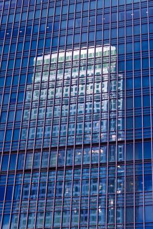 Windows on a facade of a modern office building photo