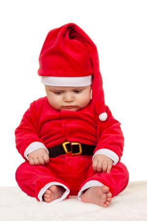 Little baby dressed as Santa Claus. Infant as Santa Claus photo