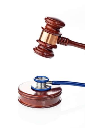 quack: Stethoscope and gavel as a symbol of medical error