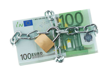 stacks of money: Euro bank notes with a lock and chain. Money stack for safety and investment. Stock Photo