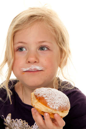 A Child in a carnival, with donuts. Donuts Stock Photo - 8362711