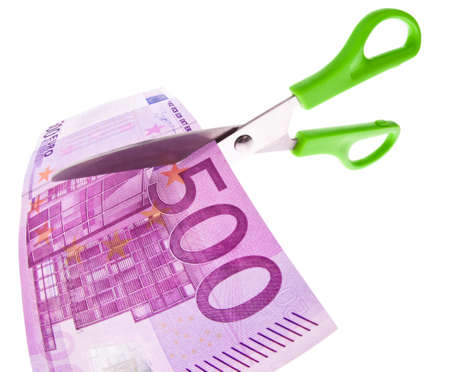 security gap: From a Euro bill is cut with scissors a piece. Symbol taxes and fees.