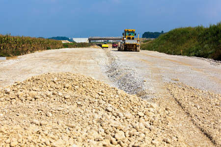 attachments: Road construction. Construction site with an excavator. Gravel and Construction