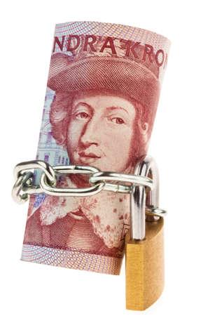 safe investments: Corona svedese, la moneta della Svezia. con serratura. Investimento sicuro. Archivio Fotografico