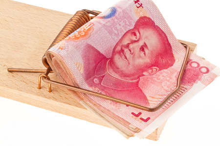 Chinese yuan banknotes in a mousetrap. Debt and budget. Stock Photo - 8408749