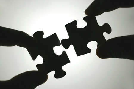 cooperation: The stones are of a puzzle together. Team spirit and cooperation