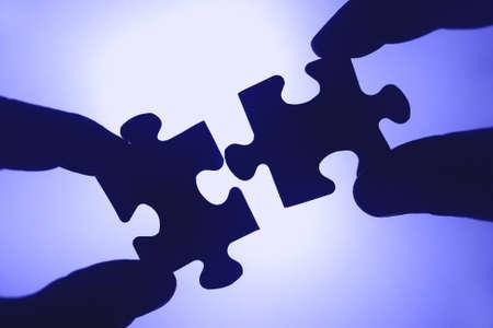 zusammenarbeit: Die Steine sind ein Puzzle zusammen. Teamgeist und Zusammenarbeit