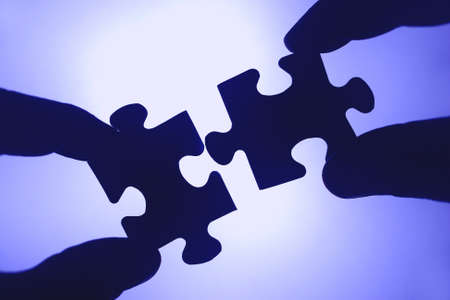 merger: The stones are of a puzzle together. Team spirit and cooperation