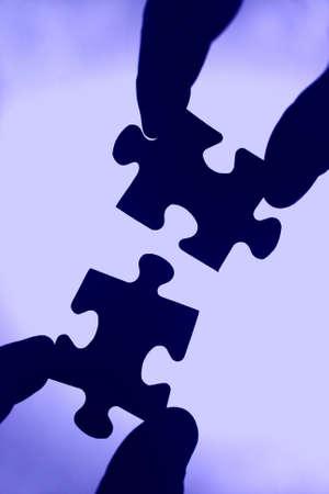 Die Steine sind ein Puzzle zusammen. Teamgeist und Zusammenarbeit