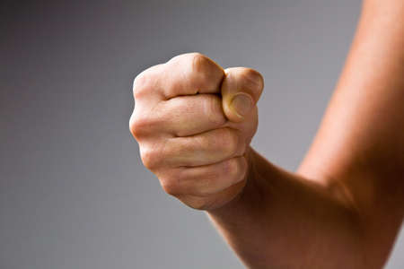 clenched fist: a clenched fist with the threat of strike Stock Photo