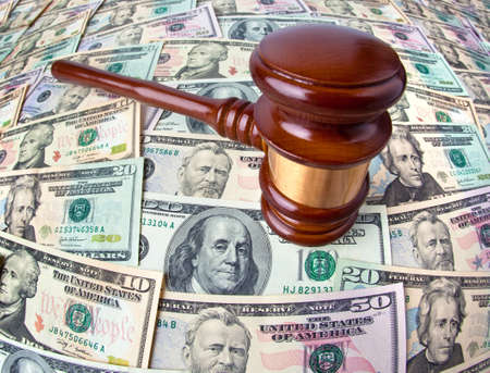 Many dollar bills and Gavel. Cost of justice. photo