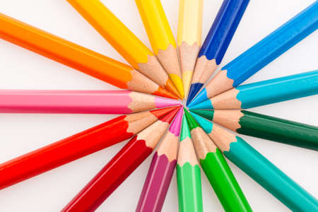 color scale: Many different colored pencils on white background