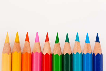 colored pencils: Many different colored pencils on white background