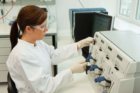 hospital fees: A woman in laboratory research. Research in the research laboratory. Stock Photo