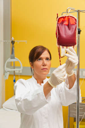 blood type: A nurse in hospital with blood bottle. Infusion of donor blood. Stock Photo