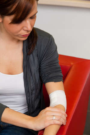 A young woman with a newly created association. After injury. Stock Photo - 8644124