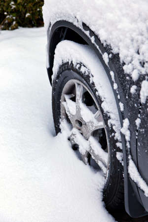 winter tires: Winter tires of a car in the snow. Driving in the winter.