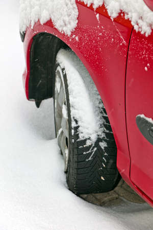 Winter tires of a car in the snow. Driving in the winter. Stock Photo - 8705610