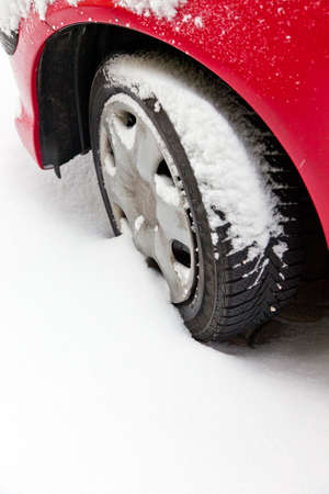 skidding: Winter tires of a car in the snow. Driving in the winter.