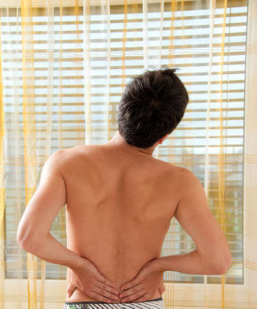 Sickness caused by pain in the back. Intervertebral disc and spinal column. Stock Photo - 8705656