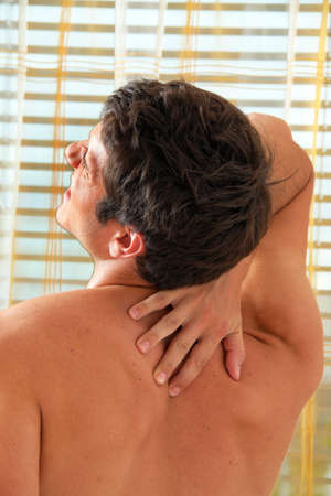 Sickness caused by pain in the back. Intervertebral disc and spinal column. Stock Photo - 8705716