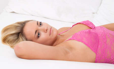 A young woman lies awake in bed. Sleepless and thoughtful. Stock Photo - 8705659