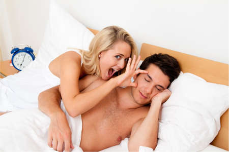 adult sex: Couple has fun in bed. Laughter, joy and eroticism in the bedroom