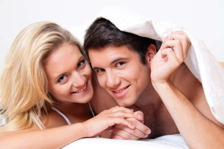 Couple has fun in bed. Laughter, joy and eroticism in the bedroom Stock Photo - 8705677