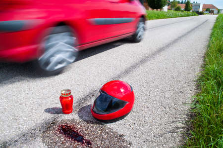 An accident with a motorcycle. Traffic accident and skid marks on road. Representative photo. photo