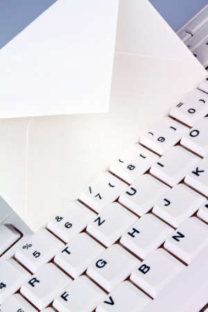 The keyboard of a computer and an envelope. Communication via e-mail. Stock Photo - 8705726