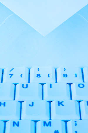 The keyboard of a computer and an envelope. Communication via e-mail. photo