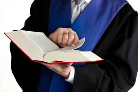 judicial: A judge with a law book in court. With Justice figure in the hand. Stock Photo