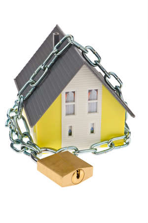 padlock shut off: A detached house with a chain and lock shut off alarm and security. Stock Photo