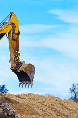 An excavator on a construction site during construction work. Excavation and dredging. photo