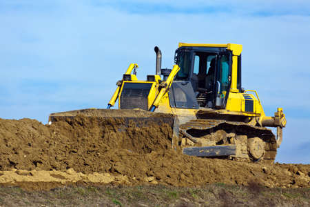 excavations: An excavator on a construction site during construction work. Excavation and dredging. Stock Photo